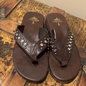 4ec9e3aab70127 Gypsy Soule Crossed Stud Sandals